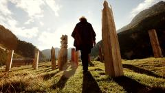 Man walking into the sun in beautiful nature scenery. spirit energy Stock Footage