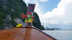 Thailand Longboat through limestone islands Stock Footage