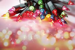 closeup of christmas lights glowing - stock photo