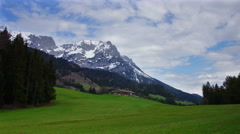 Alpine landscape with mountains and country house Stock Footage