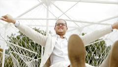 Young carefree caucasian man relaxing outdoors enjoying life Stock Footage