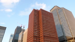 Pan Down of Building to Traffic in Central Tokyo Japan Stock Footage