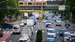 View of Traffic on Busy Boulevard from Above - Tokyo Japan Stock Footage