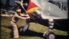 1260 - air travel in wartime plane - vintage film home movie - stock footage