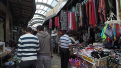 Tourists and shoppers walking by Acre grand bazaar - stock footage