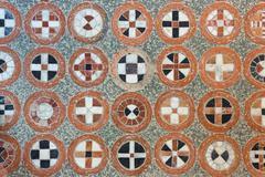 Geometric tracery on the antique floor Stock Photos