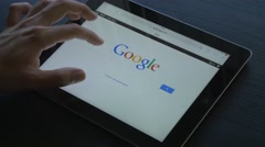 4K Google Searching Tablet iPad Device Stock Footage