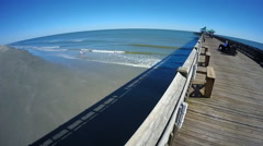 GoPro view of a fishing pier in Folly Beach, South Carolina Stock Footage