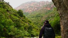 Young female tourist enjoying beautiful view in the mountains, Corsica HD Stock Footage