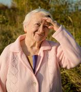 portrait of old smiling woman - stock photo