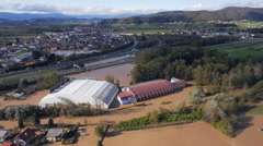 Aerial - 180° view of environmental damage by flooding. Natural disaster Stock Footage