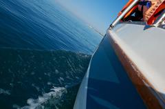Water wake behind yacht Stock Photos