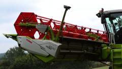 Close Up of a Combine Harvester Driving Along a Field Stock Footage