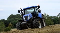 A Blue Tractor in a Field of Barley Stock Footage