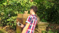Young teenager talking selfie photo with monkey in Ubud Monkey Forest in Bali HD - stock footage