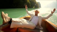 Man lying on boat deck enjoying life. carefree person. casual cloth Stock Footage