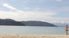 Blonde Woman Bikini Walking on Beach - Sapi Island Malaysia Stock Footage