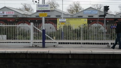 Southall railway station in London with Sikh passenger waiting Stock Footage