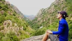 Female tourist enjoying beautiful view in the mountains HD Stock Footage