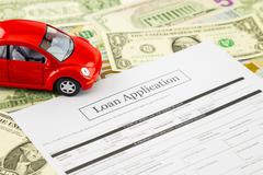 Loan application form with car and cash Stock Photos