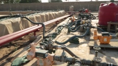 Pan of Piping and In-Ground Fuel Bladders at Airport Fuel Depot Stock Footage