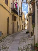 Italy, Sicily, Province of Palermo, Monreale, Alleyway and old houses Stock Photos