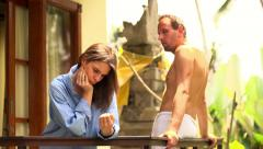 Offended, sad young couple standing on terrace HD Stock Footage