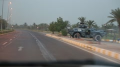 Passing Shot of Iraqi Armored Vehicle on Side of Highway Stock Footage