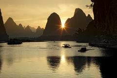 China, Guangxi, boats to transport tourists on Li river near Guilin - stock photo