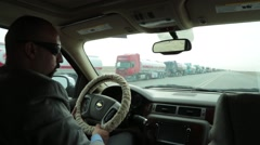 Back Seat Shot of Driver Driving the Highways of Iraq Stock Footage