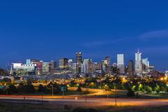 USA, Colorado, Denver, Cityscape and Interstate Highway in the evening Kuvituskuvat