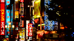 Neon Advertising Signs in the Shinjuku Shopping Ward - Tokyo Japan Stock Footage
