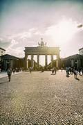 Stock Photo of Germany, Berlin, Berlin-Mitte, Brandenburg Gate, Pariser Platz and tourists