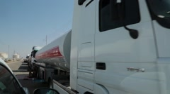 Passing Closeup of Fuel Transport Trucks Lined up at Terminal Stock Footage