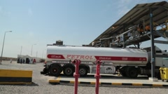 Pan Shot of Fuel Transport Truck and Filling Gangway at Fuel Terminal Stock Footage