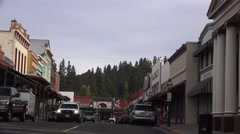 Grass Valley, Calif. gold mining town, main street turning - stock footage