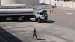 Road Fuel Tanker Slowly Pulls Away After Being Filled at Oil Terminal Stock Footage