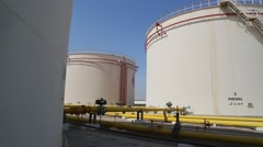Slow Pan Shot of Diesel Tanks at Fuel Depot in Iraq Stock Footage