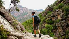 Young woman hiking in the mountains, Corsica, gorges de Spelunca HD Stock Footage