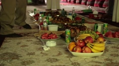 Food and Drinks Set on the Floor in Typical Middle Eastern Style Stock Footage
