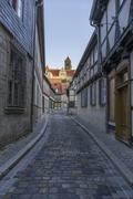 Germany, Saxony-Anhalt, Quedlinburg, Alleyway and St. Servatius church Stock Photos