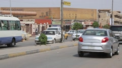 Cars Pass on Divided Street in Iraq Stock Footage