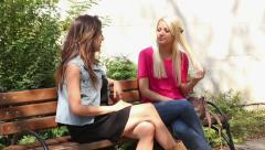 Two Young Women Talk 2 - stock footage