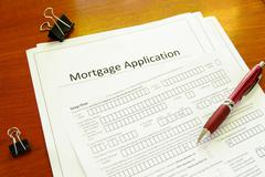 blank mortgage application with pen and clips - stock photo