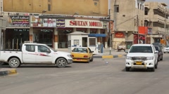 A Busy Intersection and Traffic on a Baghdad Street Stock Footage