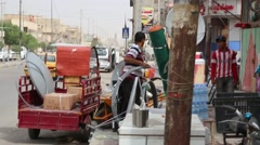 Iraqi Men Unload Hand Car Outside Baghdad Hardware Store - stock footage