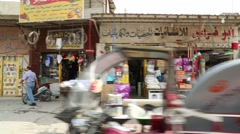 Passing Dukas (Small Retail Shops) on Baghdad Street Stock Footage