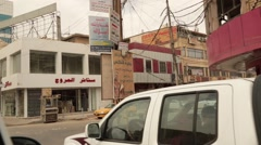 Turning a Corner on Streets of Baghdad, Iraq Stock Footage