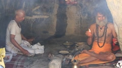 Two Indian sadhu (holy man) in the holy cave. Devprayag, India Stock Footage