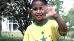 Cute Brazilian boy with a park background Stock Footage